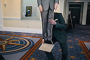 Jacob Champion, a RANDPAC volunteer, moves a cardboard cutout of Rand Paul to display at the orgination's booth during the Conservative Political Action Conference (CPAC) at the Gaylord National Resort $ Convention Center in National Harbor, Md.