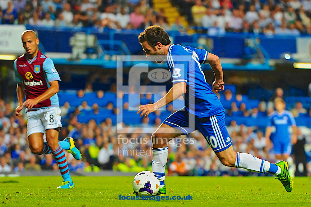 Picture by Ian Wadkins/Focus Images Ltd +44 7877 568959<br /> 21/08/2013<br /> Juan Mata of Chelsea moves away from Karim El Ahmadi of Aston Villa during the Barclays Premier League match at Stamford Bridge, London.