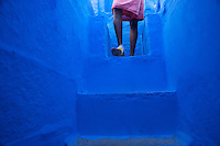A man of the Brahman cast descends the steps in his home during the morning of Diwali in Jodhpur, the Blue City, India.