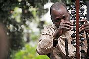 Ballaké Sissoko tuning his kora.