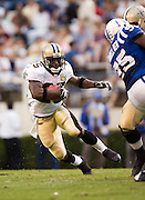 JACKSON, MS - AUGUST 26:  Running back Reggie Bush looks for a place to run during a game against the Indianapolis Colts on August 26, 2006 at Veterans Memorial Field in Jackson, Mississippi.  The Colts won 27 to 14.  (Photo by Wesley Hitt/Getty Images) *** Local Caption *** Reggie Bush