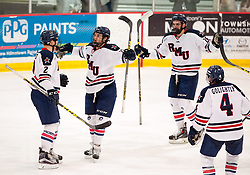 March 12 2016: Robert Morris Colonials forward Brady Ferguson (12) celebrates his goal with teammates during the second period in game two of the Atlantic Hockey quarterfinals series between the Bentley Falcons and the Robert Morris Colonials at the 84 Lumber Arena in Neville Island, Pennsylvania (Photo by Justin Berl)