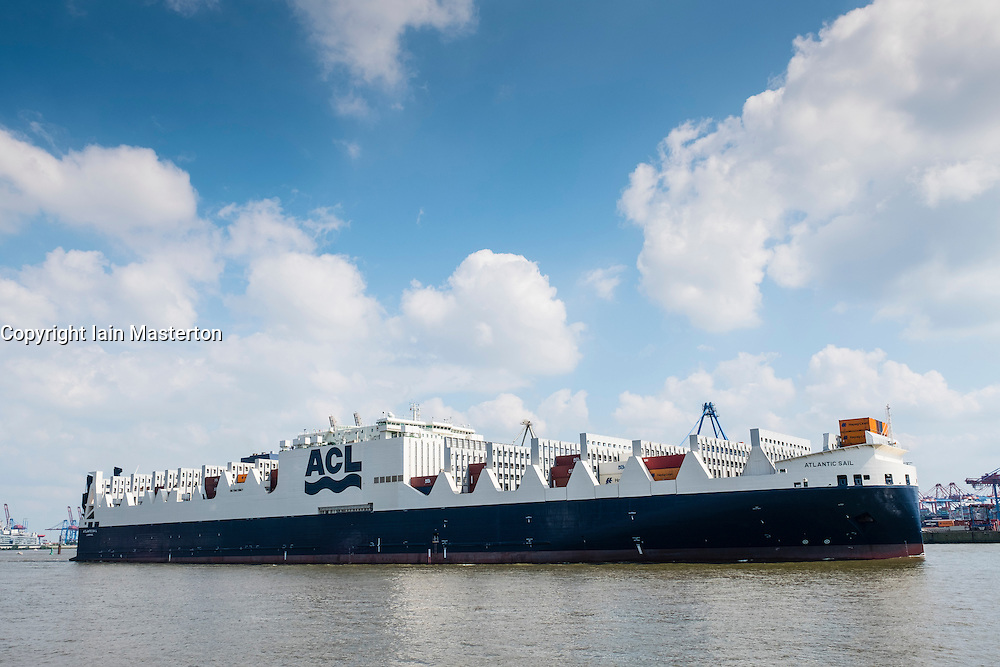 New Atlantic Sail ship leaving Port of Hamburg on River Elbe. Ship is new ACL ConRo G4 generation combined Roll -On/Roll -Off and Container ship. Containers are held in cell guides on deck preventing loss overboard.