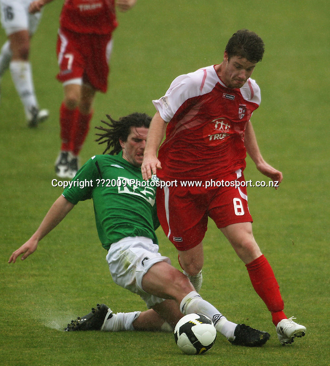 Manawatu's Nathan Cooksley tries to tackle Brent Fisher.<br /> NZFC Championship soccer - Youngheart Manawatu v Waitakere United at Memorial Park, Palmerston North. Sunday, 15 November 2009. Photo: Dave Lintott/PHOTOSPORT