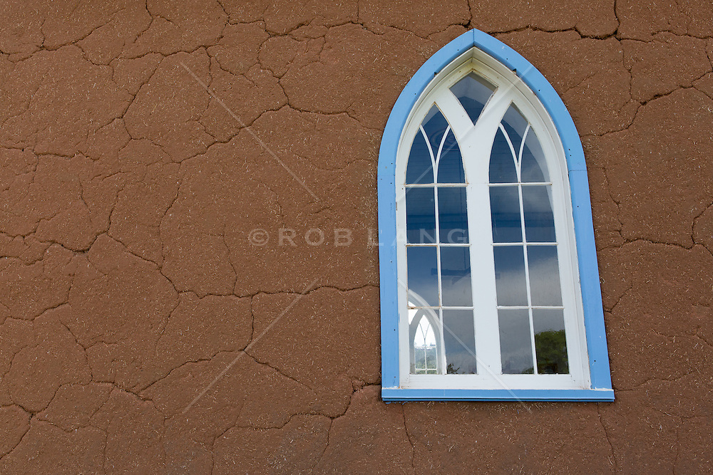 Detail of a french cathedral window at The Mission Church of San Rafael in New Mexico