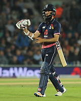 Cricket - 2017 West Indies Tour of England - Fourth One Day International (ODI): England vs. West Indies<br /> <br /> England's Moeen Ali asks to change his gloves after they went one run ahead under the 'Duckworth  Lewis ' rule at The Oval.<br /> <br /> COLORSPORT/ANDREW COWIE