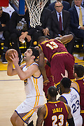 Golden State Warriors center Zaza Pachulia (27) takes the ball to the basket as Cleveland Cavaliers center Tristan Thompson (13) goes horizontal on a pump fake at Oracle Arena in Oakland, Calif., on January 16, 2017. (Stan Olszewski/Special to S.F. Examiner)