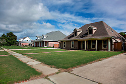 23 August 2013. Braithwaite, Louisiana.<br /> Hurricane Isaac 1 year later. <br /> The predominantly white upper middle class neighborhood of Braithwaite Park, established in 1936 remains eerie and abandoned as residents failed to return following the flooding and subsequent chemical spill from nearby Stolthaven chemical storage facility.  Insurance companies have often refused to pay residents the full value on their policies and many are now in litigation. Many houses once valued at well over $250,000 are rapidly falling into disrepair and blight. Properties are as abandoned as former residents feel, complaining that  Plaquemines Parish, the State and Federal government has done little to nothing to help them fight for their rights.  <br /> Photo; Charlie Varley