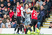 Tom Lawrence (Derby County) being seperated from Julian Jeanvier (Brentford) during the EFL Sky Bet Championship match between Brentford and Derby County at Griffin Park, London, England on 6 April 2019.