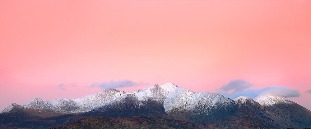Stunning Sunset Panorama of highest mountain in Ireland, Carrauntoohil with snow on top, County Kerry, Ireland / ba039