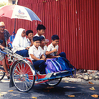 Trishawride back from school is a common scene here in Georgetown, Penang, Malaysia...Photo: Ahmad Yusni