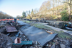 © Licensed to London News Pictures. 29/12/2015. Elland UK. Picture shows damage done to the tow path at Calder & Hebble Navigation, Park Nook Lock in Elland after recent flooding.  Photo credit: Andrew McCaren/LNP