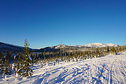Snowmobiling on Warren Wagon Road, remote winter scenic, McCall, Idaho.