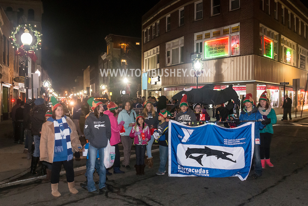 Middletown, New York - The YMCA of Middletown Barracudas swim duing at holiday parade and tree lighting on Nov. 25, 2016.