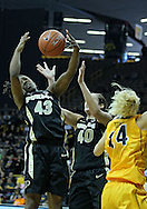 January 28, 2012: Purdue Boilermakers guard Chantel Poston (43) and Purdue Boilermakers center Chelsea Jones (40) try to pull in a blocked pass by Iowa Hawkeyes guard Jaime Printy (24) during the NCAA women's basketball game between the Purdue Boilermakers and the Iowa Hawkeyes at Carver-Hawkeye Arena in Iowa City, Iowa on Saturday, January 28, 2012.