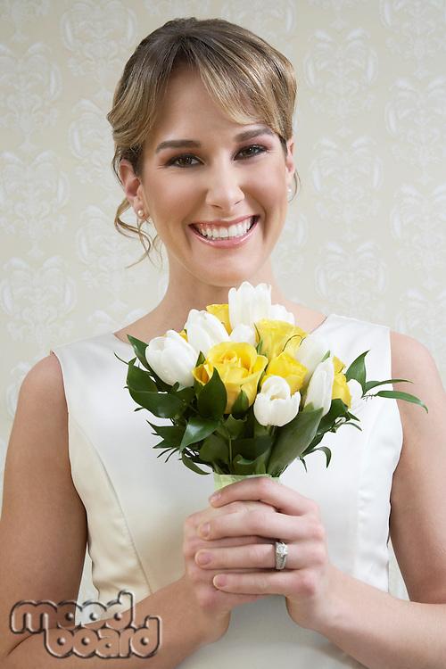 Young woman holding bouquet, portrait