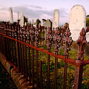 Ballarat Old Cemetery lays claim to having the richest treasure trove of burial records &amp; diversity of goldrush <br /> immigrants.<br /> <br /> German, Gaelic, French, Welsh, Hebrew &amp; many hundreds in Chinese script, who outnumbered all other groups, <br /> except the English.<br /> <br /> In 2006, up to 100 historic headstones, urns, &amp; adornments <br /> were pushed over &amp; smashed, some believed to be 150 yrs old, described as a &quot;wanton rampage of destruction&quot;.<br /> <br /> Not sure how this wrought iron fence was broken, however rust never sleeps.