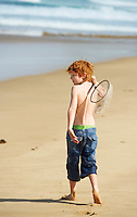 Boy Playing on Beach