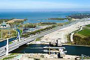 Nederland, Noord-Holland, Muiden, 20-04-2015; weguitbreiding Schiphol - Amsterdam - Almere (SAA), verbreding A1, aanleg nieuwe brug over het Amsterdam-Rijnkanaal.<br /> Widening of the motorway A1 Schiphol - Amsterdam - Almere (SAA), construction of new bridge.<br /> <br /> luchtfoto (toeslag op standard tarieven);<br /> aerial photo (additional fee required);<br /> copyright foto/photo Siebe Swart