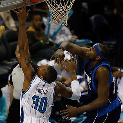 Mar 22, 2010; New Orleans, LA, USA; New Orleans Hornets forward David West (30) shoots over Dallas Mavericks center Brendan Haywood (33) during the first half at the New Orleans Arena. Mandatory Credit: Derick E. Hingle-US PRESSWIRE