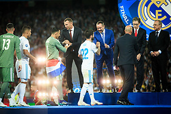 Keylor Navas of Real Madrid and Isco of Real Madrid receive their medals after the UEFA Champions League final between Real Madrid and Liverpool at NSC Olimpiyskiy Stadium on May 26, 2018 in Kiev, Ukraine. Photo by Sandi Fiser / Sportida