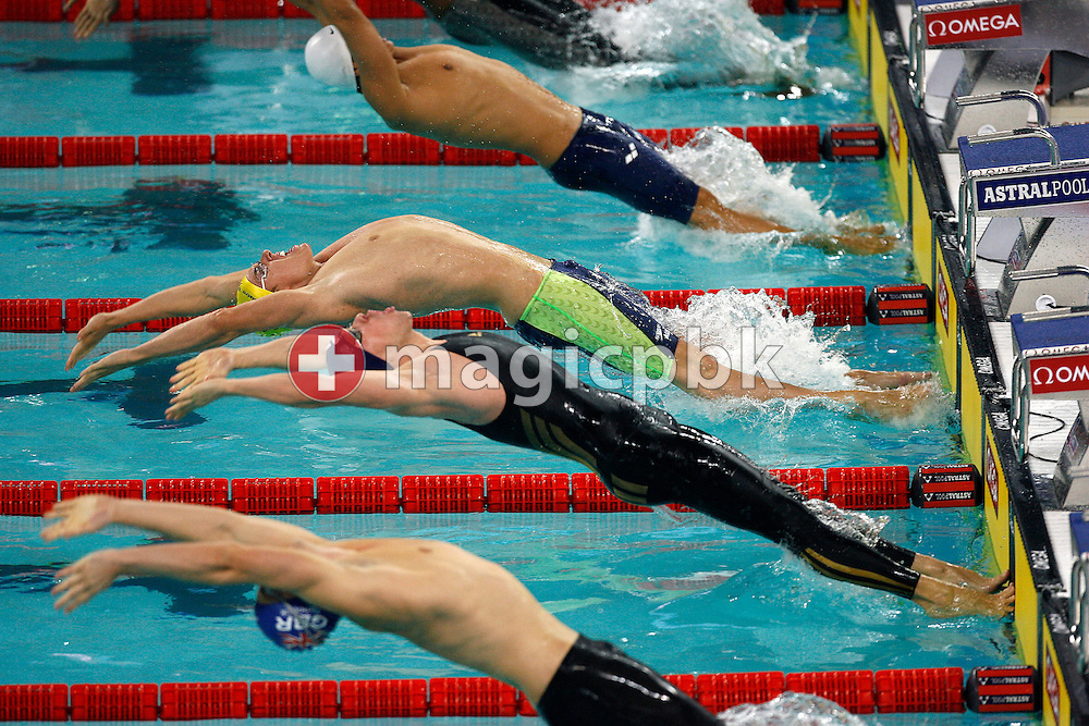 Grant BRITS (C) of Australia competes in the men's 50m Backstroke heat during day three of the 8th FINA World Swimming Championships (25m) held at Qi Zhong Stadium April 7th, 2006 in Shanghai, China. (Photo by Patrick B. Kraemer / MAGICPBK)