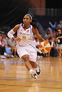 Sep 5, 2010; Phoenix, AZ, USA; Phoenix Mercury guard Temeka Johnson (2) handles the ball during the first half in game two of the western conference finals in the 2010 WNBA Playoffs at US Airways Center.  Mandatory Credit: Jennifer Stewart-US PRESSWIRE