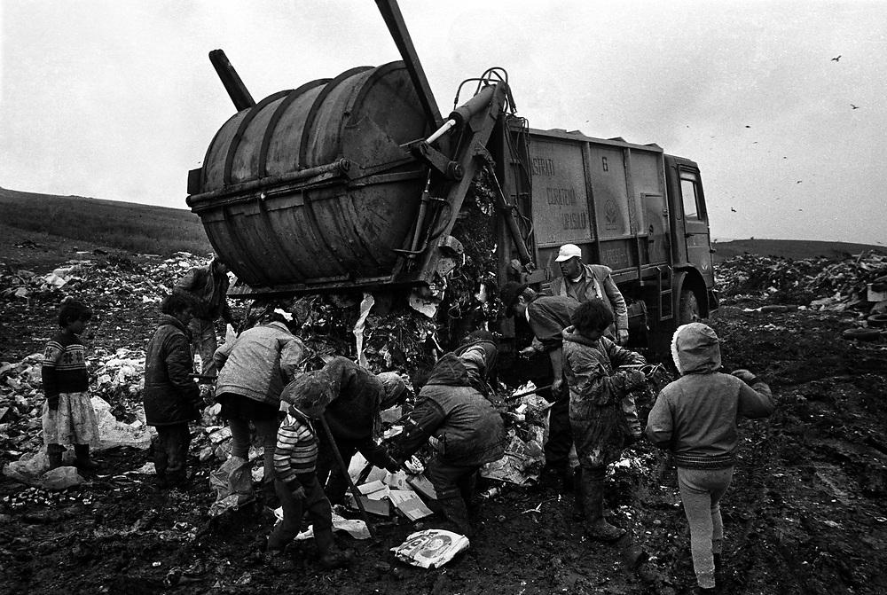 Gypsy children scavenge on the rubbish dump at the Roma community of Pata-Rat, Transylvania, Romania...©David Dare Parker / Network Photographers