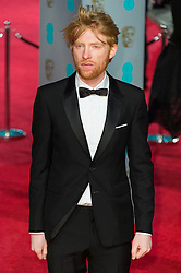 © Licensed to London News Pictures. 14/02/2016. London, UK. DOMHNALL GLEESON arrives on the red carpet at the EE British Academy Film Awards 2016 Photo credit: Ray Tang/LNP