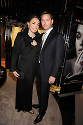 TAMARA ECCLESTONE and ROBERT MONTAGUE at a party to celebrate the launch of a collection of jewellery by Tamara Ecclestoen for jewellers Moussaieff held at their store in New Bond Street, London on 9th December 2008.