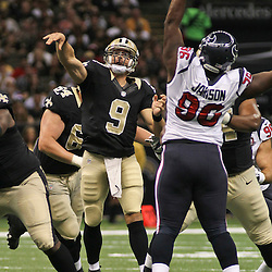 August 25, 2012; New Orleans, LA, USA; New Orleans Saints quarterback Drew Brees (9) throws a touchdown against the Houston Texans during the first quarter of a preseason game at the Mercedes-Benz Superdome. Mandatory Credit: Derick E. Hingle-US PRESSWIRE