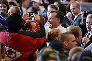 Republican presidential nominee Mitt Romney greets the crowd at the Veterans Memorial Coliseum in Marion, Ohio, Oct. 28, 2012.