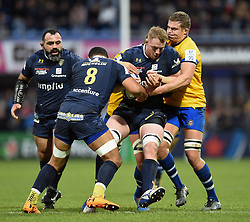 George Merrick of Clermont Auvergne is tackled - Mandatory byline: Patrick Khachfe/JMP - 07966 386802 - 15/12/2019 - RUGBY UNION - Stade Marcel-Michelin - Clermont-Ferrand, France - Clermont Auvergne v Bath Rugby - Heineken Champions Cup
