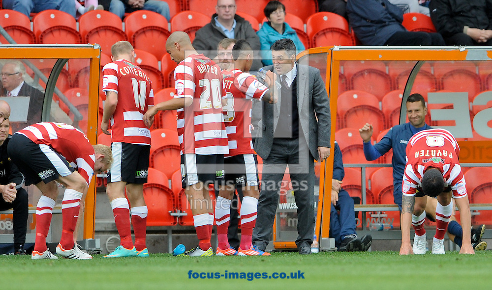 Picture by Richard Land/Focus Images Ltd +44 7713 507003.06/10/2012.Dean Saunders Manager of Doncaster Rovers passes on instructions to his team during the npower League 1 match at the Keepmoat Stadium, Doncaster.