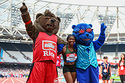 Shelly-Ann FRASER-PRYCE of Jamaica, winner of the Women's 100m poses with mascots, Tasty B and Brit Bear during the 2018 Müller Anniversary Games at the London Stadium, London, England on 21 July 2018. Picture by Toyin Oshodi.