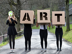 Pictured: Charly Miller, holding a painted head design and fellow an S5 pupils Momina Younis, Sophia Somerville and Neva Houston all from Drummond Community High School holding giant ART letters which forms part of the exhibition<br /> <br /> 'The Art of the Future' was an ambitious project that asked young people across Scotland what they thought the art of the future was. The results are in a display opening at the Scottish National Gallery in Edinburgh this week.<br /> <br /> © Dave Johnston / EEm