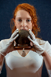 Pictured: Durrian Fraser holds the unusual coconut collection box<br /> <br /> A coconut collecting box valued at GBP500-GBP700, once in the possession of Scottish missionary John Paton, is among the highlights of the African & Oceanic Sale which takes place on 1 May.<br /> <br /> Ger Harley | EEm 29 April 2019