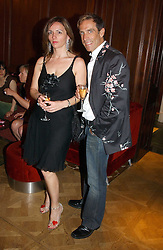 Fashion designer BEN DE LISI and MISS DEBBIE LOVEJOY at a party hosted by jewellers Adler to celebrate 20 years in London held at 5 Cavendish Square, London on 4th May 2005.<br />