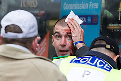 © Licensed to London News Pictures . 07/09/2013 . London , UK . An EDL supporter is injured before the march starts . The EDL hold a march and demonstration in London today (Saturday 7th September 2013) . Photo credit : Joel Goodman/LNP