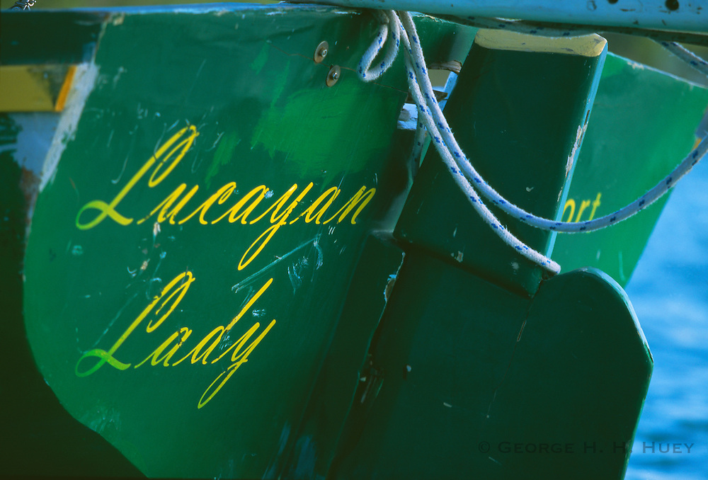 """356204-1126 ~ Copyright: George H. H. Huey ~ Name on transom of """"Lucayan Lady"""". """"A"""" class Bahamian sloop. Bahamas."""