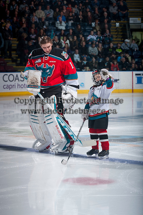 KELOWNA, CANADA - MARCH 18: The Pepsi Save On Foods Player of the Game lines up with the Jackson Whistle #1 of the Kelowna Rockets as they host the Seattle Thunderbirds on March 18, 2015 at Prospera Place in Kelowna, British Columbia, Canada.  (Photo by Marissa Baecker/Shoot the Breeze)  *** Local Caption *** Pepsi Save On Foods Player; Jackson Whistle;