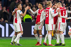 13-03-2019 NED: Ajax - PEC Zwolle, Amsterdam<br /> Ajax has booked an oppressive victory over PEC Zwolle without entertaining the public 2-1 / Dusan Tadic #10 of Ajaxscores 1-0, Noussair Mazraoui #12 of Ajax, Kasper Dolberg #25 of Ajax, Daley Blind #17 of Ajax, Donny van de Beek #6 of Ajax