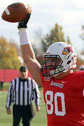 08 November 2014: James O'Shaughnessy holds the ball high in the air after catching a pass for a touchdown during an NCAA Missouri Valley Football Conference game between the Youngstown State Penguins and the Illinois State Redbirds at Hancock Stadium in Normal Illinois
