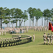 CAMP LEJEUNE, NC  - APRIL 30:  Major Mike Weber stands at attention in front of the 90 memorials as colors are presented at the 2nd Marine Expeditionary Brigade service honoring the unit's Marines and sailors killed during their recent deployment to Afghanistan on Friday, April 30, 2010 in Camp Lejeune.The 2nd MEB deployed to Afghanistan's Helmand province in April 2009 in support of NATO's International Security Assistance Force. The unit spent nearly 12 months partnered with Afghan security and other NATO forces prosecuting a highly successful campaign against Taliban and other anti-government forces in southern Afghanistan.  The MEB returned to the United States earlier this month. (Photo by Logan Mock-Bunting/ZUMA Press)