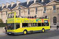 Tour bus at the Louvre in Paris France