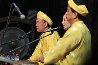 Musicians provide narration and music during a performance at the Golden Dragon Water Puppet Theatre in Ho Chi Minh City, Vietnam