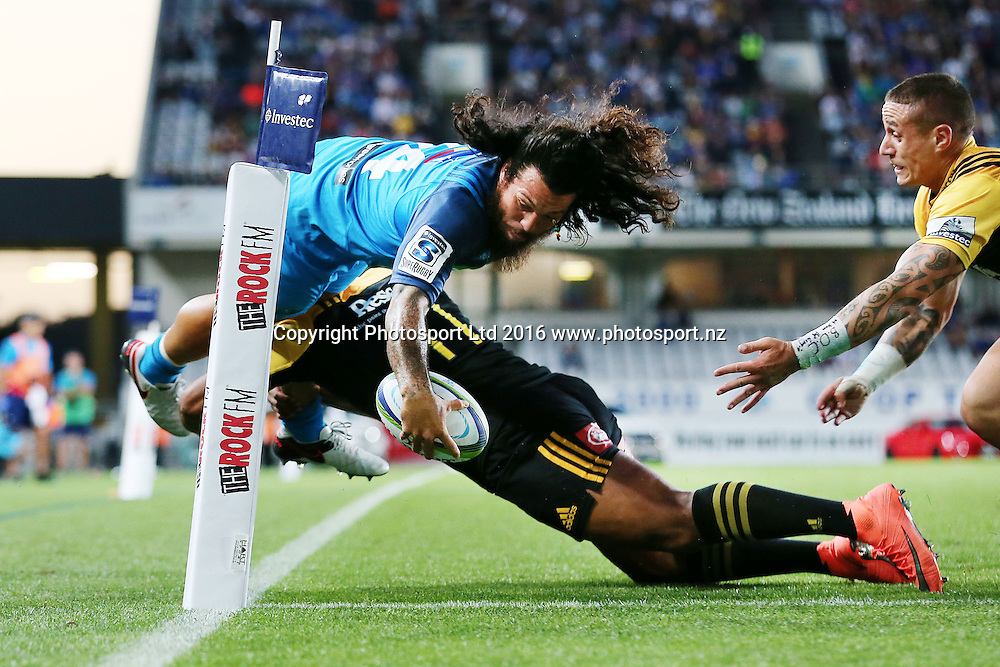 Rene Ranger of the Blues scores a try against Julian Savea and TJ Perenara of the Hurricanes. Super Rugby match, Blues v Hurricanes at Eden Park, Auckland, New Zealand. 11 March 2016. Photo: Anthony Au-Yeung / www.photosport.nz
