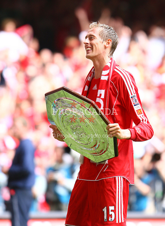 CARDIFF, WALES - SUNDAY, AUGUST 13th, 2006: Liverpool's Peter Crouch lifts up the trophy after 2-1 victory over Chelsea during the Community Shield match at the Millennium Stadium. (Pic by David Rawcliffe/Propaganda)