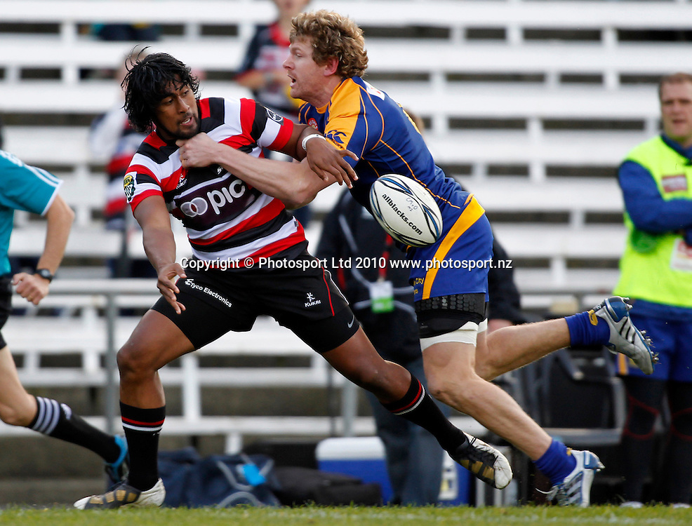 Counties winger Ahsee Tuala offloads in the tackle of Otago's Adam Thomson. ITM Cup Rugby, Counties Manukau v Otago, Bayer Growers Stadium, Pukekohe. Saturday 31st July 2010. Photo: Simon Watts/PHOTOSPORT