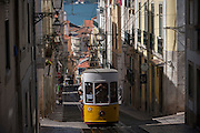 The funicular tram makes its way up the steep gradient of Rua de Bica de Duarte Belo (Elevador da Bica) in Bairro Alto, Lisbon, Portugal.